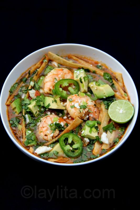 Shrimp tortilla soup with avocado