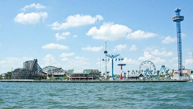 Just outside of Houston there is Kemah Beach and Kemah Boardwalk.  Good family fun.