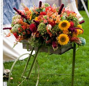 fall bouquet in wheelbarrow. Yep I think I need to do something like this in my metal trike basket out front.