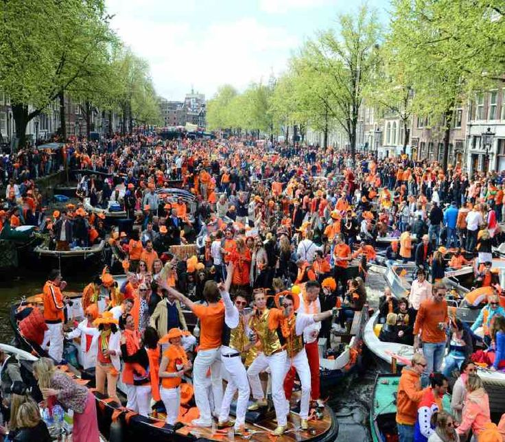 King's Day Amsterdam Holland - The city is crowded on the 27th April 2016 with people dressed in orange to celebrate this national holiday. Live music, parties, markets and orange-pride everywhere: King's day! Discover more unique travel inspiration on www.broscene.com !