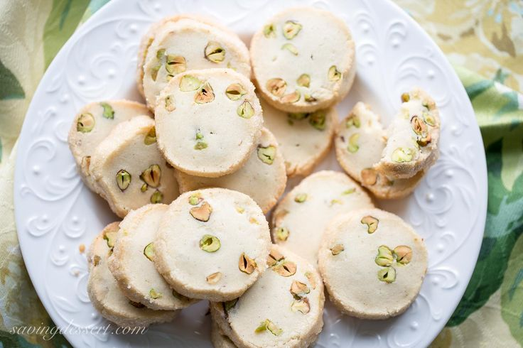 Pistachio Shortbread Cookies - A simple slice and bake shortbread cookie loaded with buttery flavor, vanilla beans and pistachios.