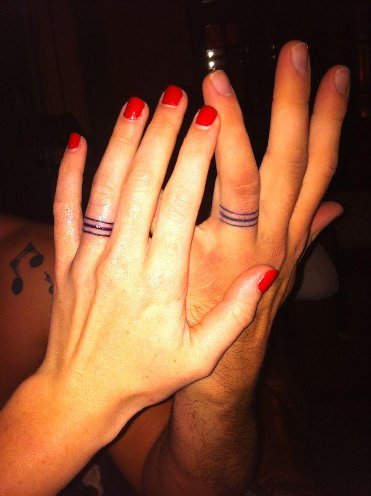 Awesome wedding ring tattoo