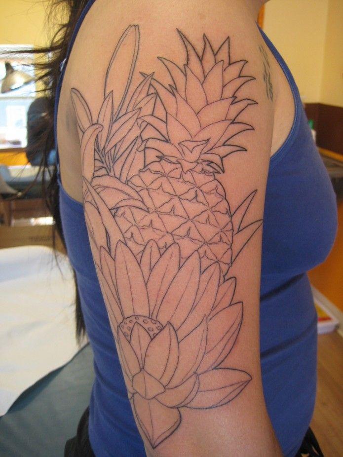 flower-pineapple tattoo on arm