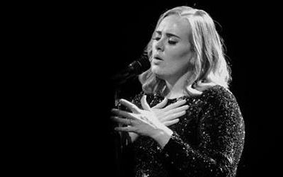 Adele Kiss: Was It Staged? Concert Earnings Revealed! - http://www.fxnewscall.com/adele-kiss-was-it-staged-concert-earnings-revealed/1944826/
