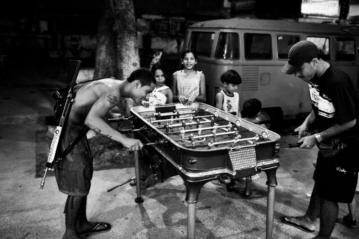 -Bande Giovanili- ©Pina Joao A young drug trafficker plays fussball with another young man in Morro do Dende (dende slum) in northern Rio de Janeiro, Brazil