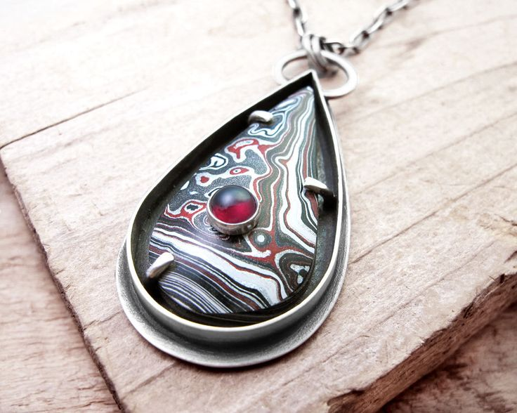 Fordite necklace, Detroit Agate, Garnet, fordite jewelry, sterling silver necklace, silversmith, stone on stone by lulubugjewelry on Etsy https://www.etsy.com/listing/251011967/fordite-necklace-detroit-agate-garnet