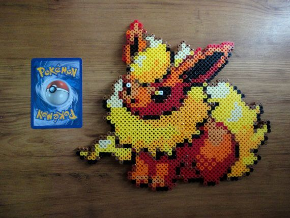 Hey, I found this really awesome Etsy listing at http://www.etsy.com/listing/156590355/flareon-pokemon-perler-bead-sprite
