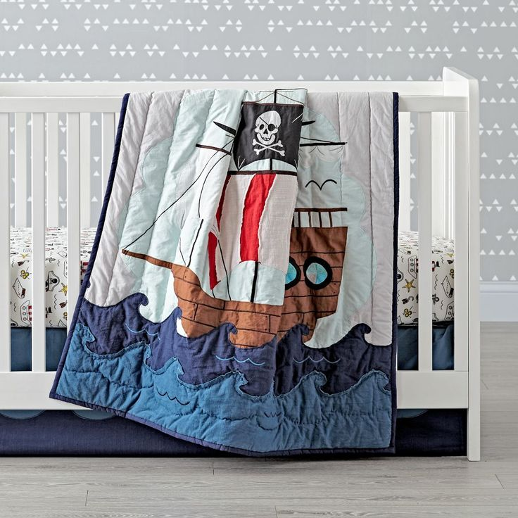 Shop Pirate Crib Bedding.  Yo ho ho, our Pirate Crib Bedding is ready to set sail.  Adorned with an embroidered pirate ship, as well as various printed elements, this 100% cotton crib bedding set is perfect for any nursery.