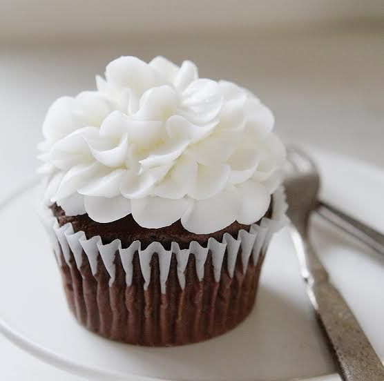 The Perfect Chocolate Cupcakes with beautiful Whipped Buttercream Flowers on top!