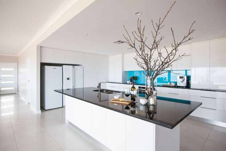 A large kitchen area above makes entertaining for the adults and teenagers very easy. The front door, that allows for natural light to filter through the four panels of glass is also larger than normal. This is a popular way to really make a statement at the entrance of your home.