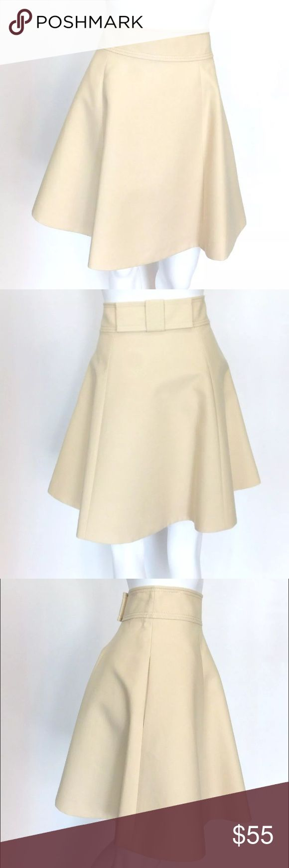 Kate Spade Terra Skirt PreLOVED! Kate Spade Terra Skirt From the Capri Italy Collection Color: Beige (Raw Almond) Size 6 100 % Cotton Full Skirt Lined Pockets Adorable Flat bow on the back Retail $298.00 kate spade Skirts A-Line or Full