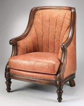english style carved mahogany highback tub chair the backrest with channel tufted paisley upholstery the seat and back upholstered in leather with