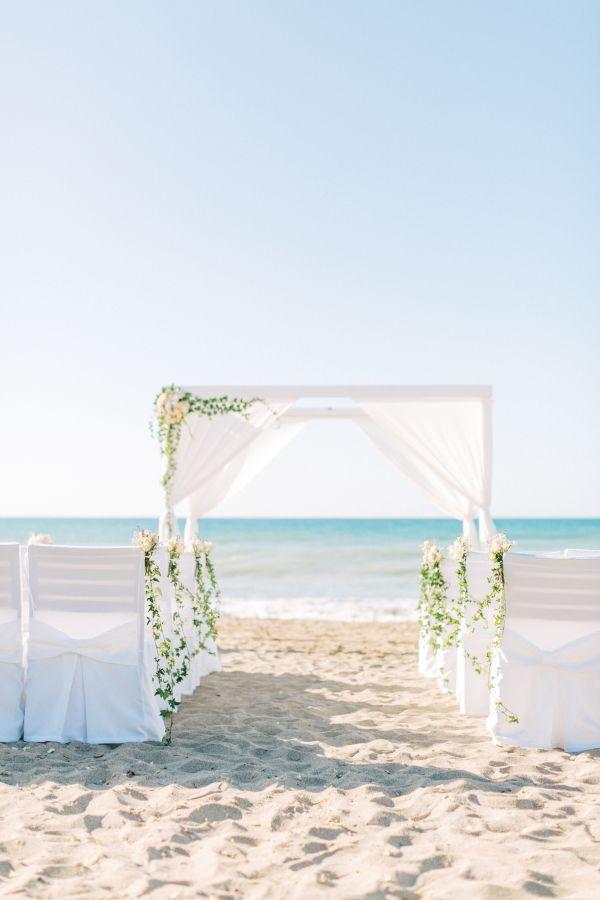 Beach wedding ceremony set up in Crete. MOMENTS  www.weddingincrete.com