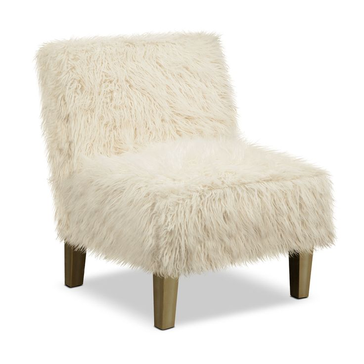 Shaggy Chic. For those who like to style their favorite spaces with a little more character, there's the Westie accent chair. You can't help but run your hands through the white, faux sheep fleece upholstery that covers it. But this overstuffed design isn't just about looks; it's well built too. The exclusive, patinaed finish on the hardwood frame required a ten-step process.