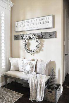 Love this cozy and inviting farmhouse entryway. #farmhouse #entryway #cozy #bench #decor