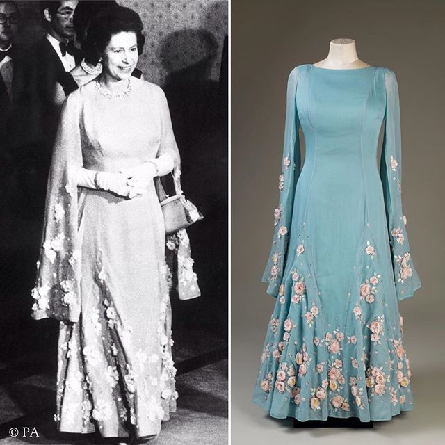 Norman Hartnell designed this blue silk and silk chiffon dress for The Queen to wear during a State Visit to Japan in 1975. It is embroidered with sprays of cherry blossom, the national flower of Japan.  #Queenat90 #HM90fashion #fashion #style #HMTheQueen #TheQueen #instastyle #cherryblossom #embroidery