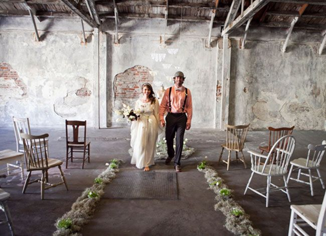 Dress up a simple rustic space with an asile of flowers. Check out these beautiful pictures from greenweddingshoes.com