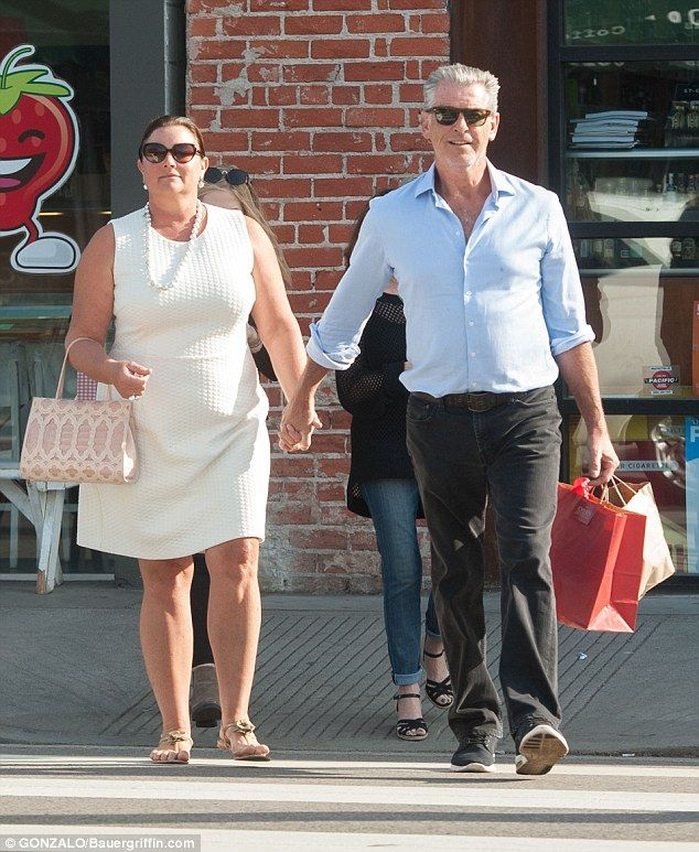 Loved-up: Pierce Brosnan cut a romantic figure with beloved wife, Keely Shaye Smith, on Th...