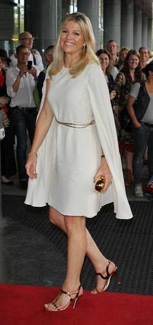 """Daytime Chic: Princess Máxima looks chic and elegant--yet still very on-trend with this ivory boat-neck dress with cape """"sleeves"""""""