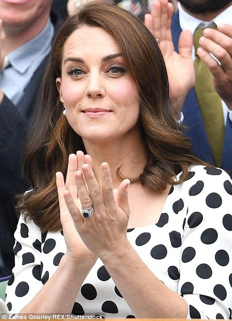 Round of applause: Kate claps as she cheers on defending champion Andy Murray...