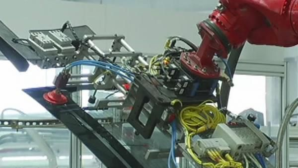 Students get tour of Tesla factory Bay Area, electric cars TESLA saw one k. H1 LOOKS cool lines, lots of style.