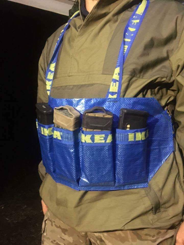 A rather clever use of materials. This is a great way to recycle those IKEA bags. Even though the blue IKEA bags are not free, @akraix2 used one to make a chest rig. Looks like it would be very light weight and hold up to light duty.