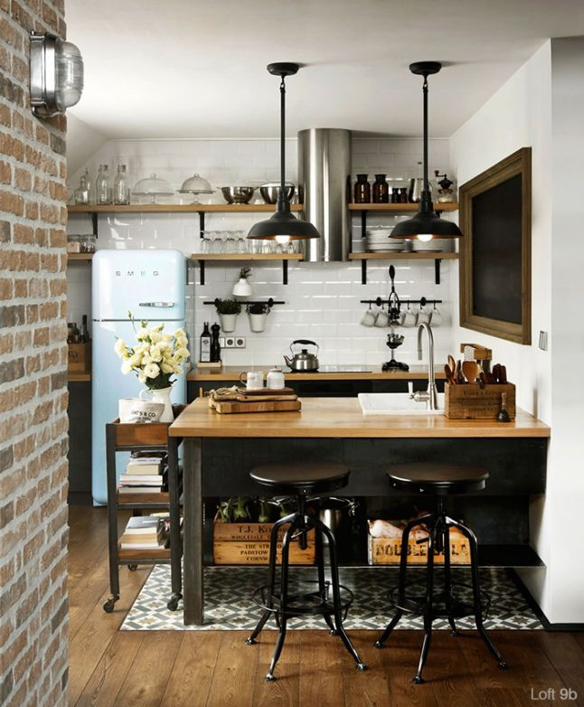 Charm filled compact kitchen has all of the essentials including a place to eat at the counter. #VintageIndustrial