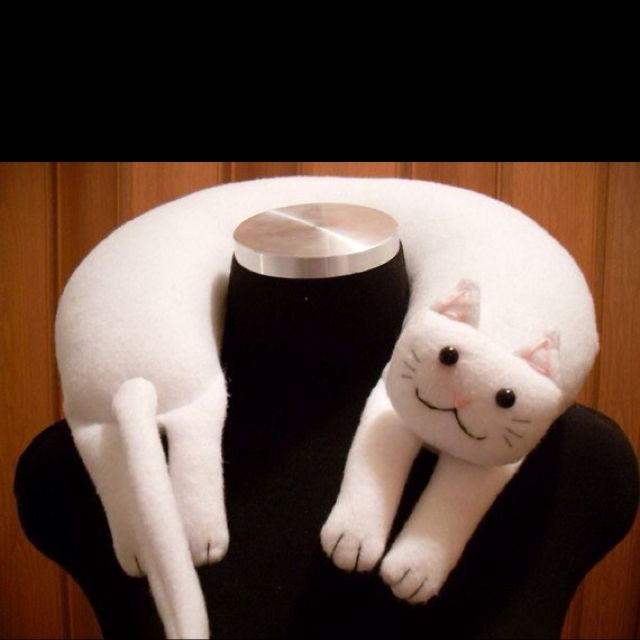 Kitty neck pillow from Etsy