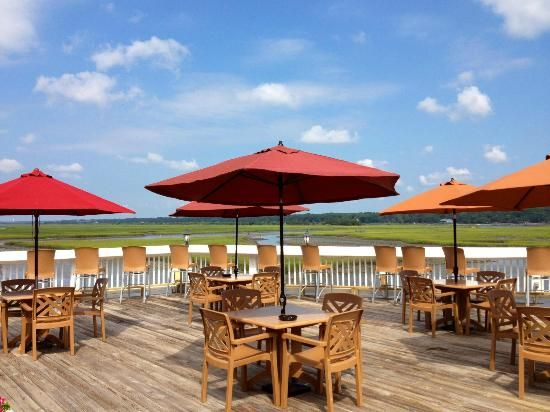 Pogie's Restaurant in Ocean Isle Beach, NC - beautiful waterfront dining with live music! Check it out while you're on vacation with Sunset Properties! #vacation #summer #food