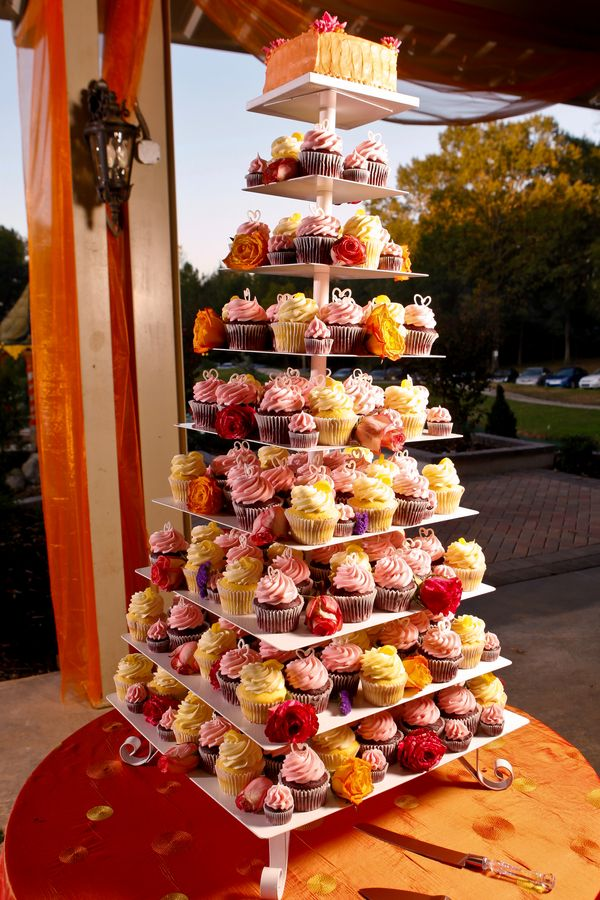 Cupcake tower and each cupcake can be put in a pretty box as a favour for guests.