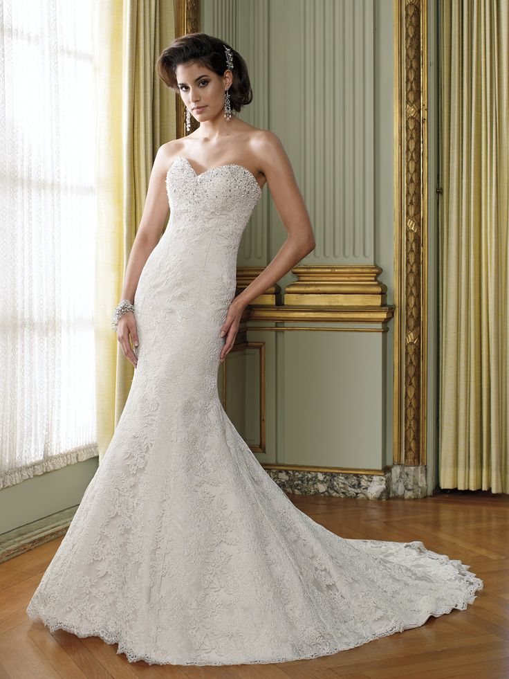 David Tutera for Mon Cheri-- Kelly.   Loved it at Uptown Bridal, Chandler.  Sheer separate wraps a little crazy though. $1000.