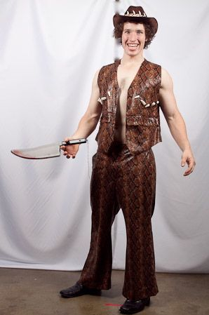 Crocodile Dundee costume available for hire in store. Available in Medium and Large. Costume incluces vest, trousers, hat and imitation knife.