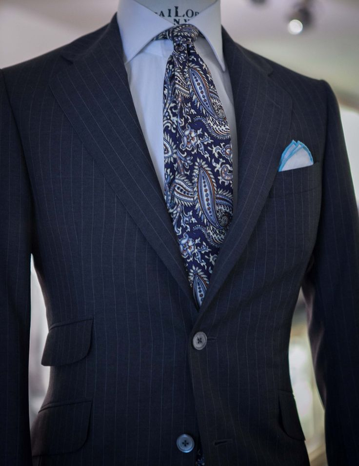 A paisley tie always gets our vote! A trendy, yet classic business professional outfit for men.