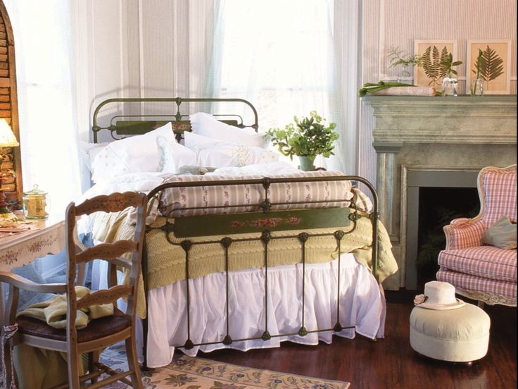 Cozy but airy bedroom, with lovely rod iron bed