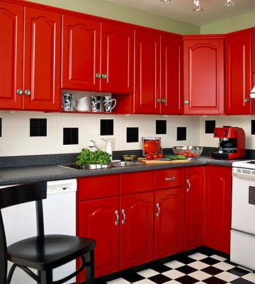 Black and white checked floor and red cabinets. Love this retro feel kitchen
