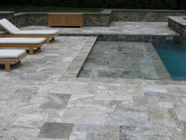 Silver Travertine Pavers The most magnificent pavers on the planet! Every piece is so unique and beautiful. Anyone that wants a paver to replace the color of bluestone should check out our Silver Travertine. Even though it is dark, it STAYS COOL, EVEN IN DIRECT SUNLIGHT!