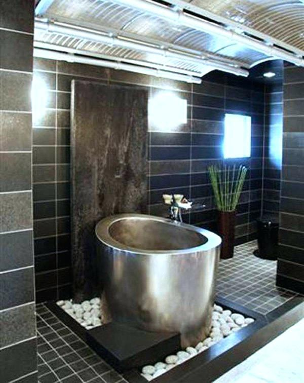 Metallic Compact Bathtub In A Tile And Stone Mount The Combination ...