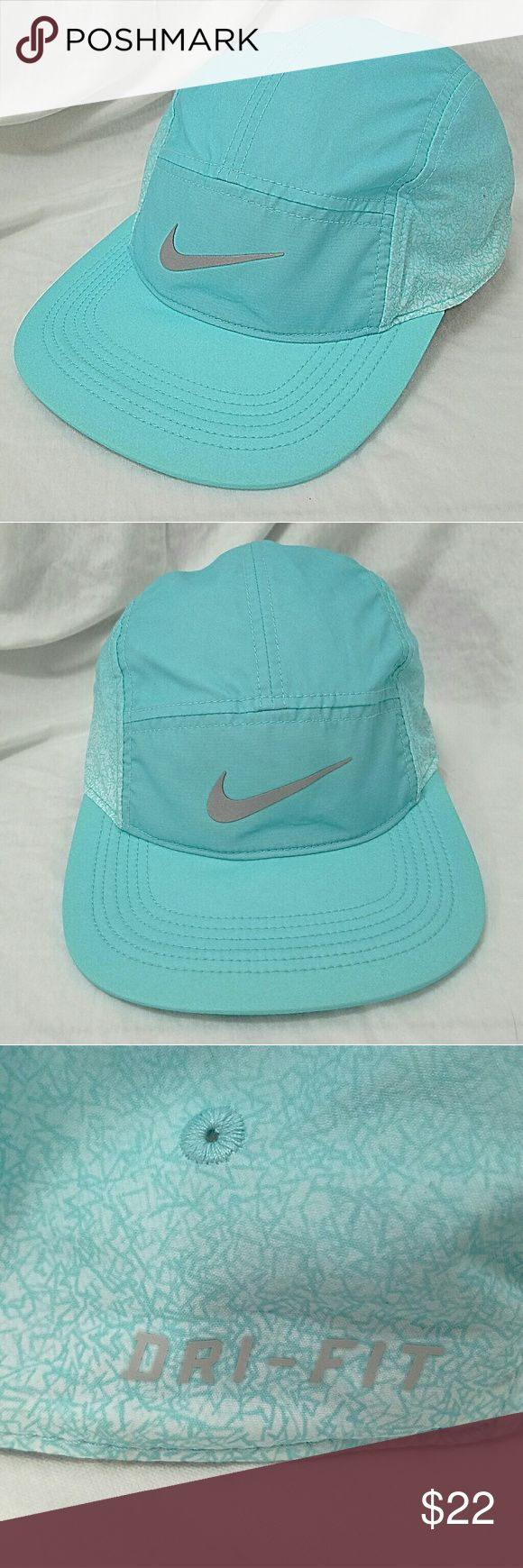 NIKE Women's Dri-Fit Aqua Blue Running Ball Cap Brand: Nike  Item: *Dri Fit Ladies Baseball Cap Hat *Silver Reflective Swoosh on the Front *The Side Panels Look Like a 'Scribble' Pattern *The Back Has an Adjustable Strap for Fit. *Inside Tag Says AW84 *One Size Fits All *Excellent, Like New Pre-Loves Condition  *Please check my lisings if you happen to be looking for more ladies caps and would want to bundle  *no trades, offers via offer button only* Nike Accessories Hats