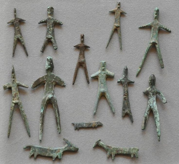 Umbrian votive figurines, 6th-5th  century B.C. Etruscan Umbrian votive figurines, stylized bronze figures comprising male, female and three animals, bull, dog and sheep, each with their arms outstretched, punched circles for eyes, breasts and navels, 6.7 cm high max. Private collection