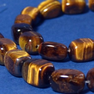 Tiger Eye (Cat's Eye, Falcon's Eye or Hawk's Eye) gemstone meaning    Tiger Eye lets you see everything. Use it for insight and you can be a very lucky person. When used in jewelry the tiger eye may bring good luck and protection from the evil eye to the wearer. It also known to bring clear thinking and insight.  Healing properties of Tiger Eye    A stone for the mind, not the body. Tiger Eye is used to focus the mind. It makes one aware of one's own needs related to the needs of others.