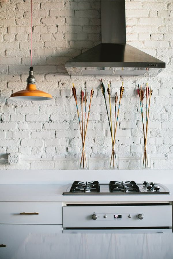 Clean and white kitchen with arrows in vases - via www.murraymitchell.com