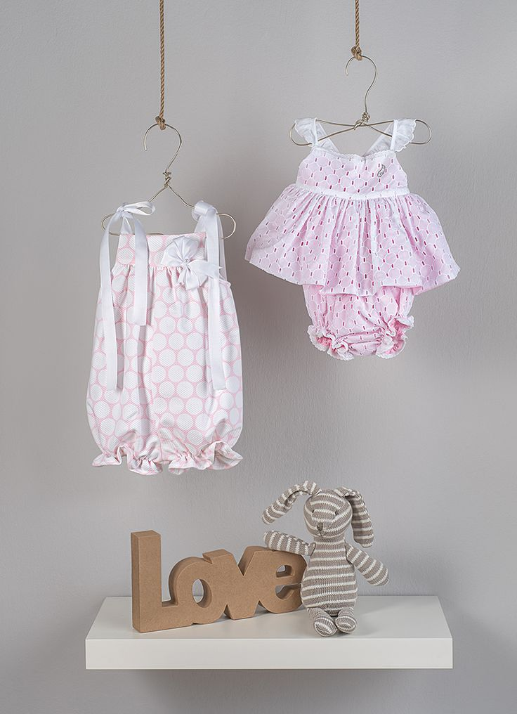 Bodysuit on pink color with white polka dots from pique cotton with satin ribbon and bow ornament  A set consists of a top made in broderie anglaise cotton fabric doubled with pink poplin. It ties on the back with a bow from cotton voile fabric. Shorts from fabric broderie anglaise in cotton fabric doubled with pink poplin