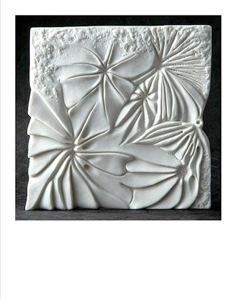 Ceramics by Maggie Barnes at Studiopottery.co.uk - 2009. Coral, carved porcelain tile.  12cm. x 12cm. Photography by David Chalmers Limited