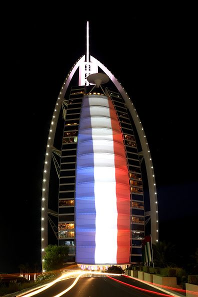 The Burj Al Arab Hotel is illuminated in the colours of the French flag on…