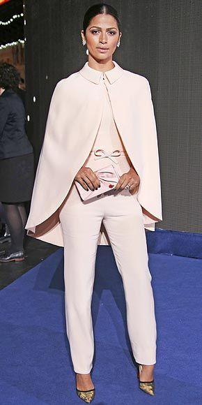 CAMILA ALVES | To support her husband at the Interstellar premiere in London, she flaunts a super feminine blush-colored Georges Hobeika jumpsuit that comes with a matching cape. Both her satin clutch and mesh pumps are Christian Louboutin.