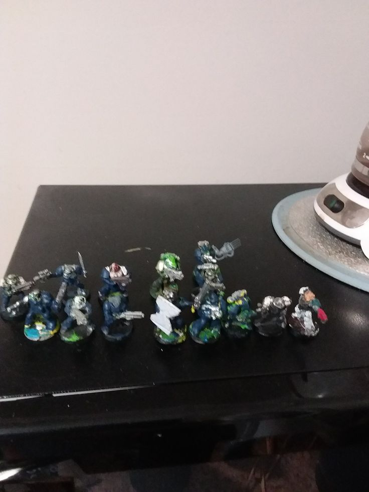 Space marine scouts and regular space marines with medal ones.