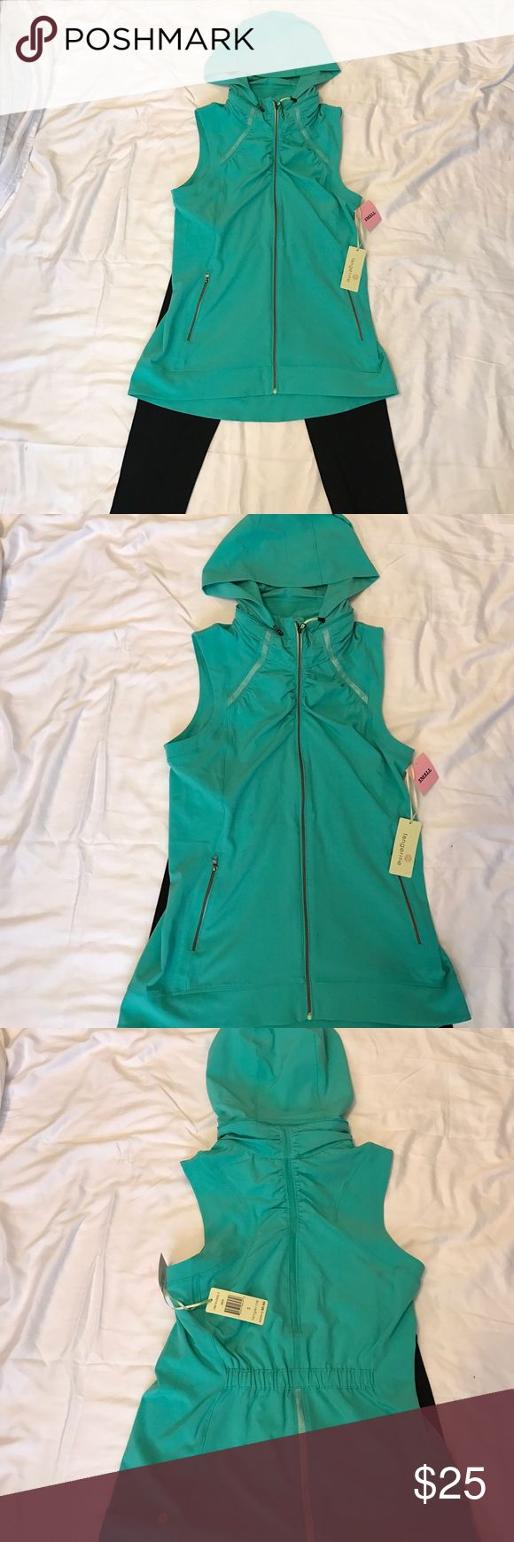 Tangerine stretch active sleeveless jacket Color is AQUA ,ladies small ,%90 Polyester,%10 spandex,machine wash cold delicate cycle,do not bleach ,tumble dry low tangerine  Jackets & Coats Vests