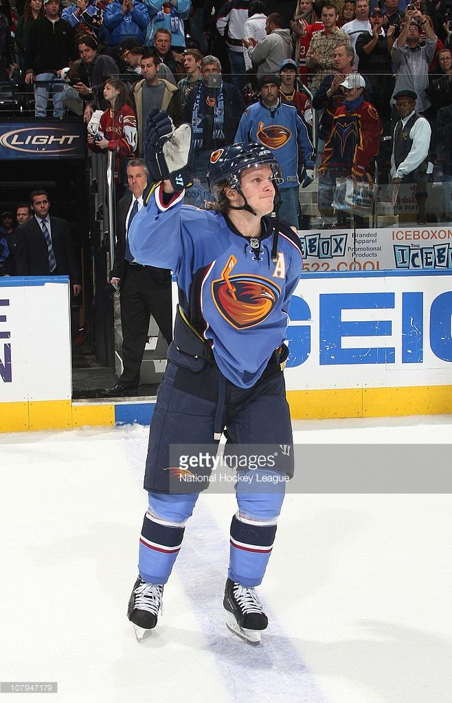 Tobias Enstrom #39 of the Atlanta Thrashers acknowledges the crowd after being named 1st star of the game against the Boston Bruins at Philips Arena on December 30, 2010 in Atlanta, Georgia.