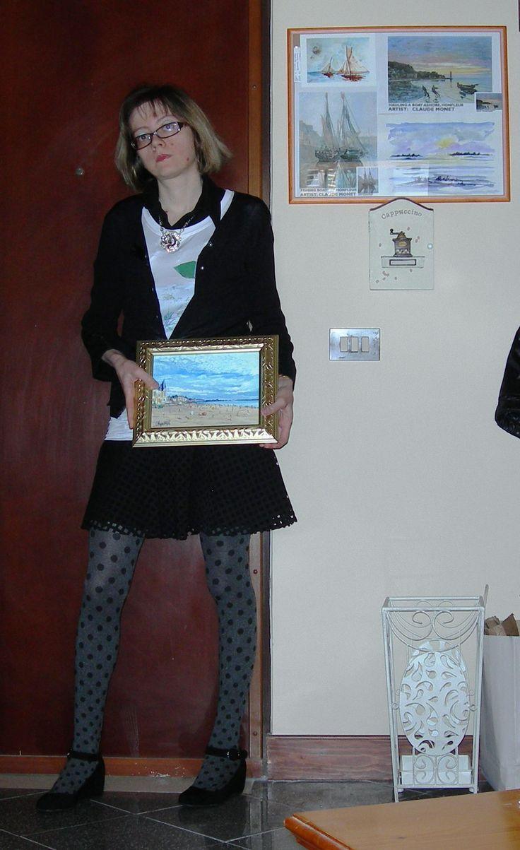 E per chiudere... io con una mano il quadro del pittore francese Remy Chapelle che rappresenta la spiaggia di Trouville in Normandia...