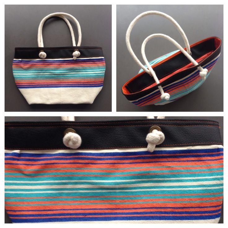 Descripción: Bolso cartera. Color: negro, naranja, azul Medida: 27x42cm